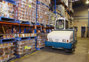 Warehouse sweeping by our Tennant ride-on sweeper