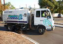 Roundabout sweeping by the Scarab Merlin truck-mount sweeper